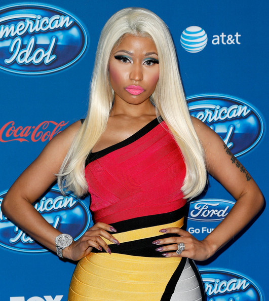 {Nicki Minaj and her over the top Barbie-doll look.