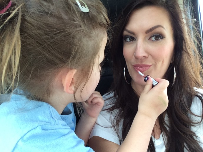 Vivian helping mommy apply her lipgloss
